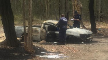 People collecting scrap metal discovered a body in a burnt-out ute on Thursday.