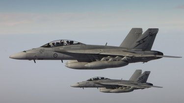 RAAF F/A-18F Super Hornets return after completing a combat mission over Iraq.