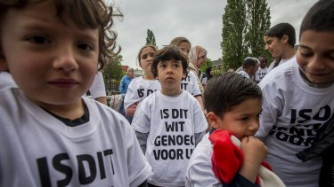 Pupils from a primary school in Amsterdam wear t-shirts that read 'Is this white enough for you?' on Friday.
