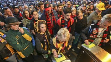 Crowds of people line up at Richmond station as fans are forced to swipe their myki cards.