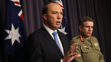 Immigration minister Peter Dutton and Major General Andrew Bottrell at Parliament House on Friday.