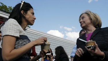Democratic presidential candidate Hillary Clinton and aide Huma Abedin (left) in New Hampshire.