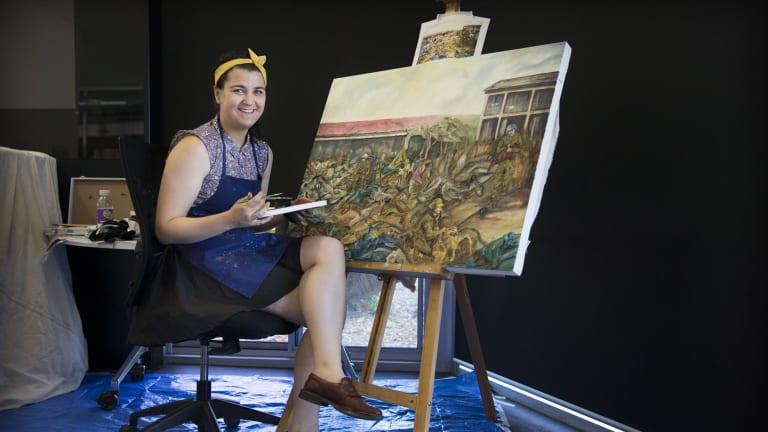 Australian Army Staff Cadet Bethany Gallagher, of the Royal Military College, Duntroon, completes a painting.