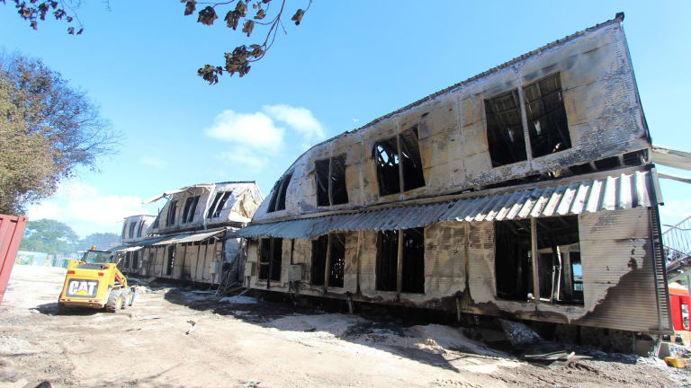 Accommodation buildings at the Nauru detention centre following the 2013 riot and fire.