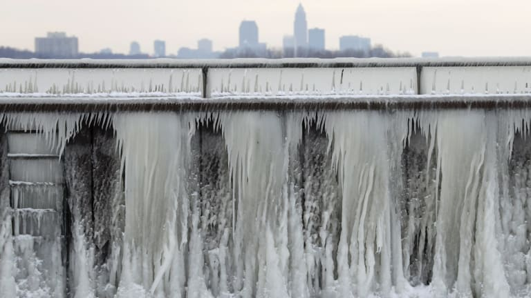 Ice forms on a breakwall along Lake Erie with the city of Cleveland in the background last Wednesday. Dangerously cold temperatures have gripped wide swaths of the US from Texas to New England.