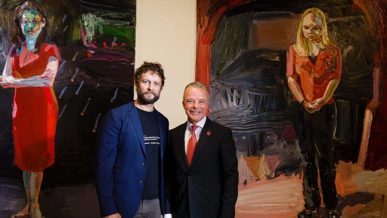"""Artist Ben Quilty and Australian War Memorial director Dr Brendan Nelson in front of Quilty's work """"The Longest War."""""""