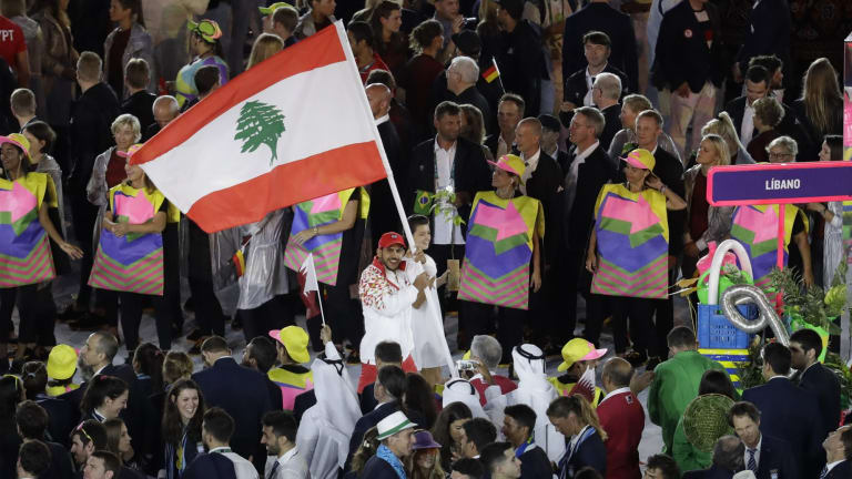 Nacif Elias carries the Lebanese flag during the opening ceremony of the Rio Olympics.