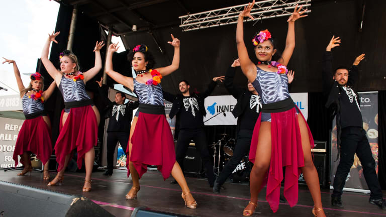 Enjoy music and dance at Bairro Portugues, the Portuguese food and wine fair.