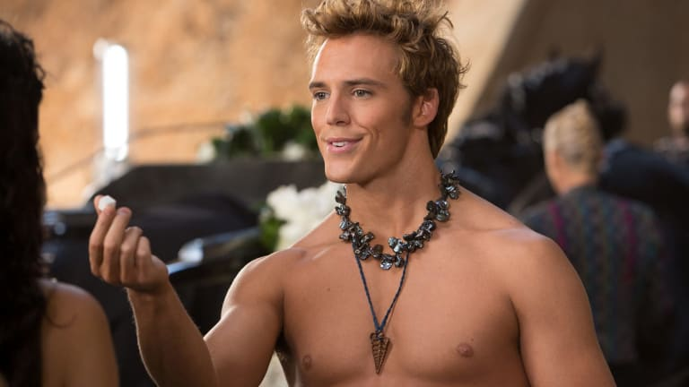 Sam Claflin as Finnick Odair in The Hunger Games movie Catching Fire.