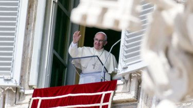 Pope Francis waves from his window overlooking St Peter's Square on Sunday.