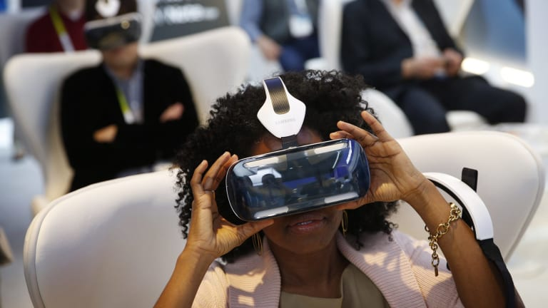 Attendees use Samsung's Galaxy Gear VR headset at CES.