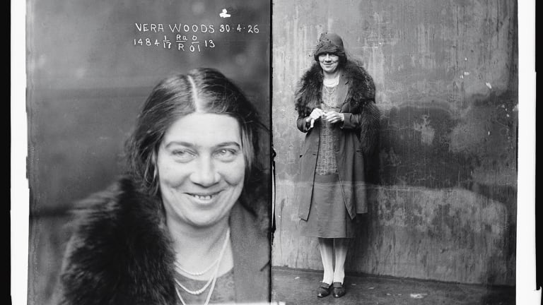Suspect Vera Woods, April 30, 1926, grins at the photographer.
