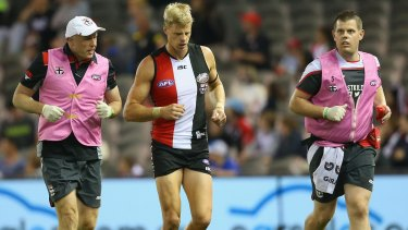 Nick Riewoldt comes off the ground after a big hit in the last quarter.