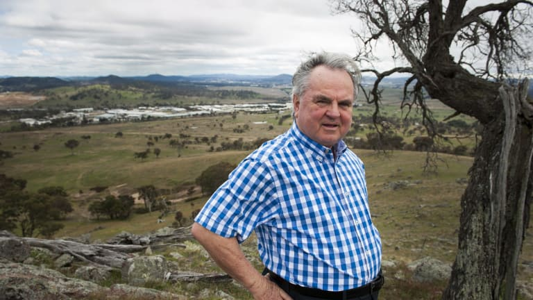 Village Building Company's former managing director Bob Winnel, pictured in 2015 overlooking South Jerrabomberra.