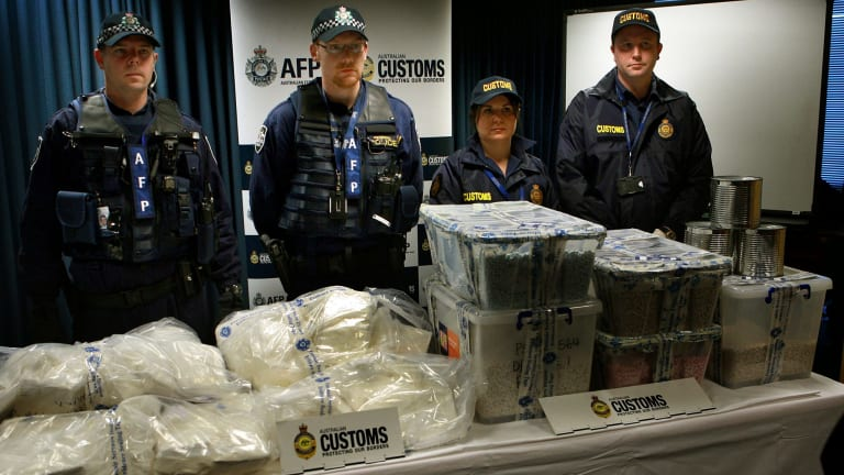 Federal Police and Customs agents with some of the Ecstasy and Cocaine after the drug bust.