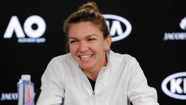 Romania's Simona Halep smiles at a press conference at Melbourne Park.