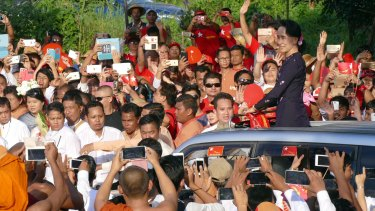Myanmar opposition leader Aung San Suu Kyi greets supporters upon arrival at an election campaign rally for her National League for Democracy party on Sunday.