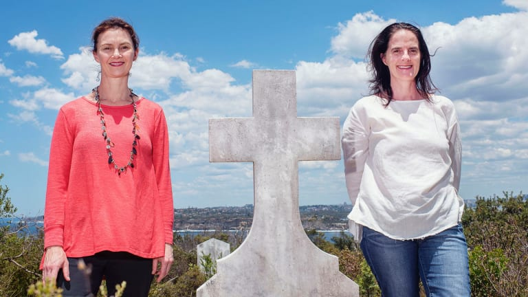 """Curator Katherine Roberts (left), pictured with artist Susan Milne at North Head, described the site as """"an amalgam of Australian history""""."""