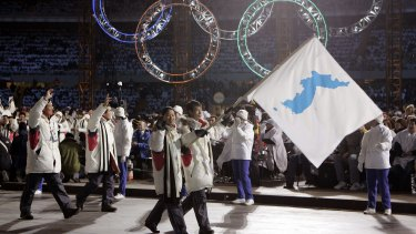 Korean flag-bearer's Bora Lee and Jong-In Lee carry a unification flag during the 2006 Winter Olympics opening ceremony in Turin, Italy.