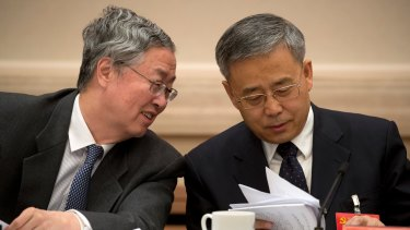 China's hardline banking regulator, Guo Shuqing, right, with Zhou, began cracking down on shadow credit in February.