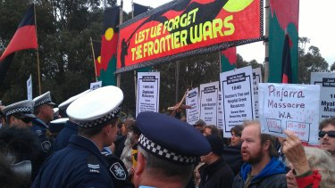 Protesters attempting to crash the 2014 Anzac Day march in Canberra clash with police.