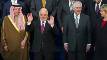 A penny for your thoughts: Iraqi Prime Minister Haider al-Abadi (hands raised) with US Secretary of State Rex Tillerson and Foreign Minister Julie Bishop in Washington on March 22.