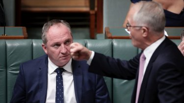 Prime Minister Malcolm Turnbull makes a point in Parliament, watched by Barnaby Joyce.