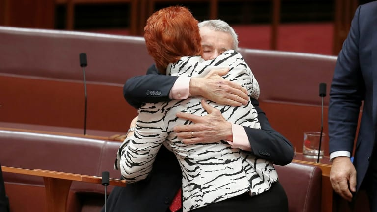 Senator Roberts is congratulated by Senator Pauline Hanson after delivering his first speech.