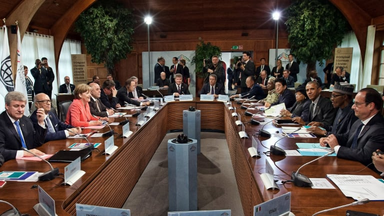 Global heads: G7 leaders and outreach guests including Germany's Chancellor Angela Merkel and US President Barack Obama attend a working session at the summit.