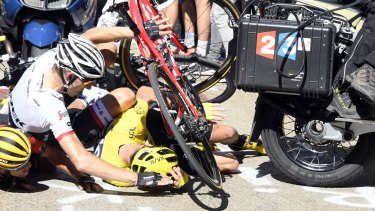 Pile-up: Chris Froome, right, wearing the yellow jersey, Bauke Mollema, centre and Richie Porte .