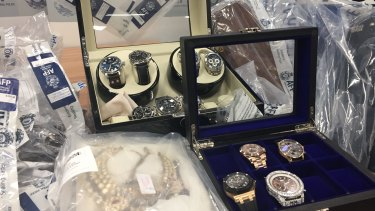 Police have seized hundreds of items, including watches, cars, motorbikes, planes, properties and cash.