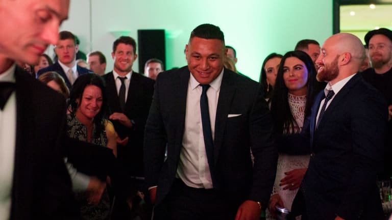 Josh Papalii heads to the stage after being named the Raiders' joint player of the year with Josh Hodgson.