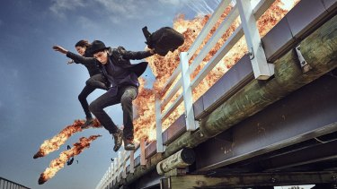 Molly Daniels and Narek Arman jump from the Barwon Heads bridge on the set of the ABC TV series <i>Tomorrow When the War Began</i>.