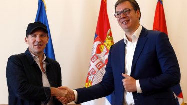 British actor and director Ralph Fiennes, left, shakes hands with Serbian President Aleksandar Vucic, during a meeting in Belgrade, Serbia, on Sunday.