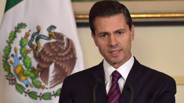 Mexican President Enrique Pena Nieto addresses the media at the Mexican embassy in Paris on Sunday.
