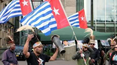 Activists campaigning for Papuan independence dance outside the Dutch Parliament in The Hague in April.