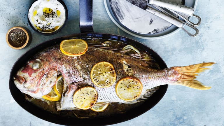 Baked snapper with dill cream and burnt onions.
