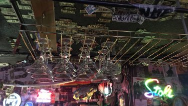 The Willow Den has dollar bills and Playboy magazine covers that line its walls.
