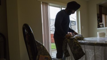US Army Captain Simratpal Singh, who was recently granted a temporary religious accommodation that allows him to grow his beard and wrap his hair in a turban, at home in Auburn, Washington, this month.