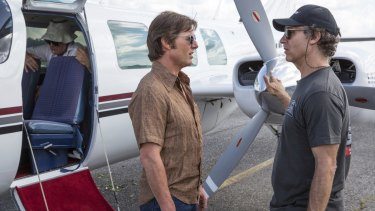Tom Cruise and director Doug Liman on the set of American Made.