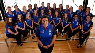 North Melbourne women's football operations manager Laura Kane with other female staff who work at the club.