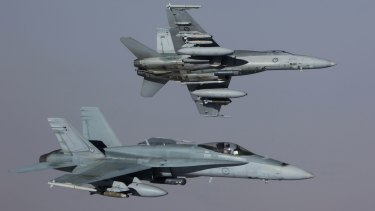 Two of the RAAF's planes returning to base after striking a Islamic State Armoured Personnel Carrier in Syria. .