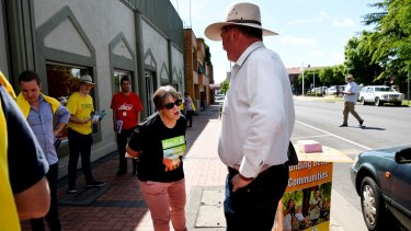 Mr Joyce is confronted by a Greens volunteer as he visits a pre-polling station in Armidale on Tuesday.