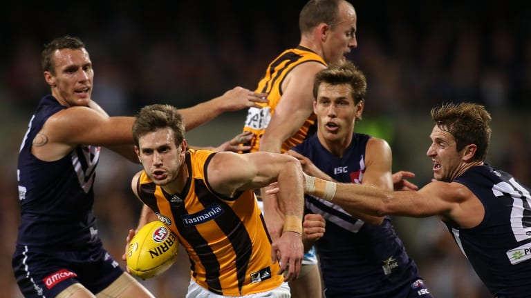 Grant Birchall of the Hawks breaks from a pack during Friday's preliminary final.