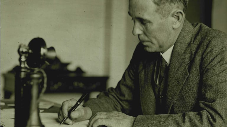 Ben Chifley in 1940, adjusting his Commonwealth Bank legislation. Mindful of the Depression's lessons, the then treasurer believed strongly in government control of banking.