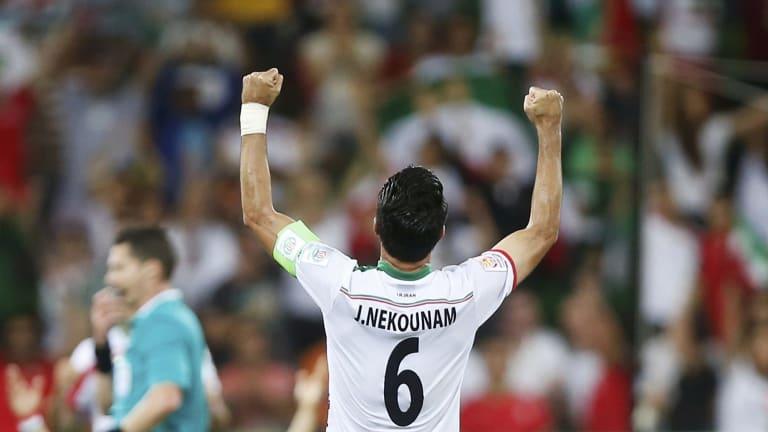 Javad Nekounam celebrates Iran's Asian Cup group stage win over Bahrain.