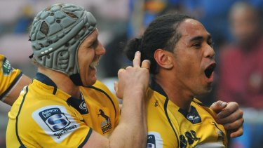 Joe Tomane of the Brumbies celebrates scoring the opening try.