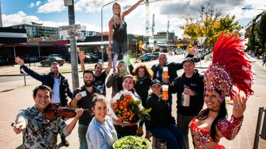 Braddon business owners and performers get into the party mode on Lonsdale Street.