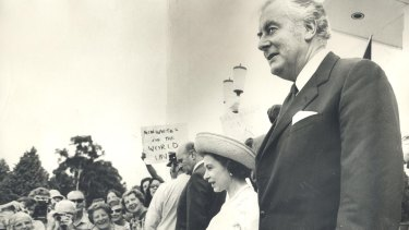 The Queen and Prime Minister Gough Whitlam walk down the steps of the Parliament House in 1973.