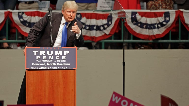 Republican presidential candidate Donald Trump gestures as he speaks during a campaign rally in North Carolina.